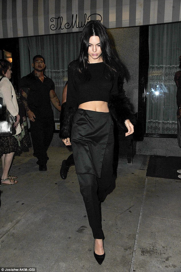 Busy girl! After a hectic day walking for Diane Von Furstenberg, Kendall Jenner chose to let her hair down by heading to dinner with her sisters at the city's Il Mulino restaurant on Sunday night