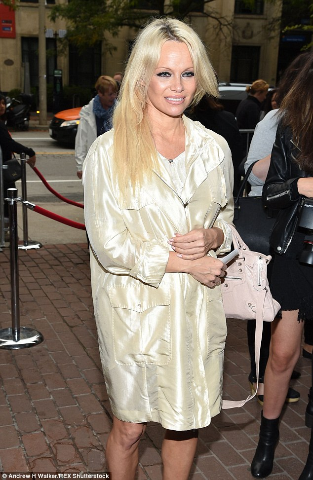 Pop of color: The 48-year-old added a light pink handbag to her outfit as she headed to the screening