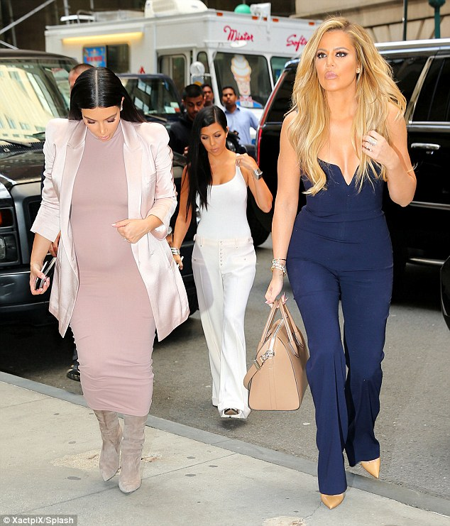 Reality stars: Khloe was joined by pregnant sister Kim Kardashian West, who also launched her paid website today, and sister Kourtney Kardashian