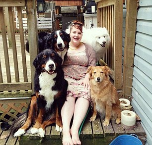PIC FROM MERCURY PRESS (PICTURED: Shandess Griffin, 29, from Canada with her dogs that she photographs daily and posts about online) These bark seat drivers ñ weighing a combined total of more than 300lbs ñ have captured the hearts of animal lovers everywhere. Shandess Griffinís hilarious viral photo captures five of her furry friends squashed into the back of a friendís small Volkswagen Rabbit. But luckily for the 29-year-old these pooches are perfectly well-behaved; as her snaps of them in a variety of adorable poses prove. SEE MERCURY COPY