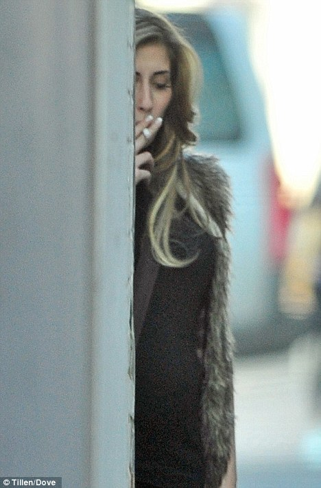 Sneaky puff: Seven months pregnant Stacey was spotted smoking down an alley way, but says the criticism she has received is a 'little harsh'