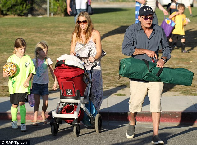 Parking it: The 46-year-old actor spent a lovely, summery California day with his ex and kids