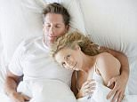 A stock photo of a man and a woman snuggling in bed asleep.    AA68NN  Image shot 2007. Exact date unknown.