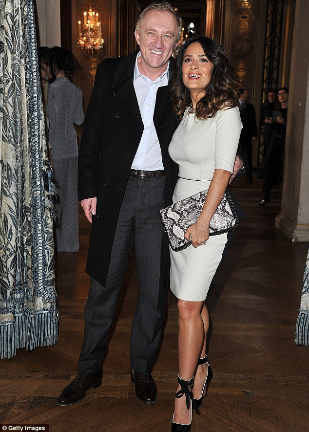 Happy together: Salma attended the show with her husband Francois-Henri Pinault