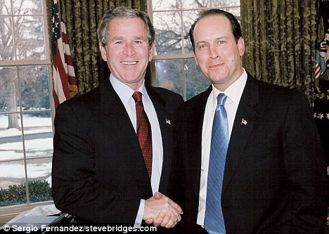Friends: Bridges, right, met Bush at the White House in 2003, pictured