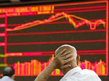 An investor looks at an electronic board showing stock information at a brokerage house in Beijing, China, August 25, 2015.   China's major stock indexes sank more than 6 percent in early trade on Tuesday, after a catastrophic Monday that saw Chinese exchanges suffer their biggest losses since the global financial crisis, destabilising financial markets around the world.    REUTERS/Kim Kyung-Hoon