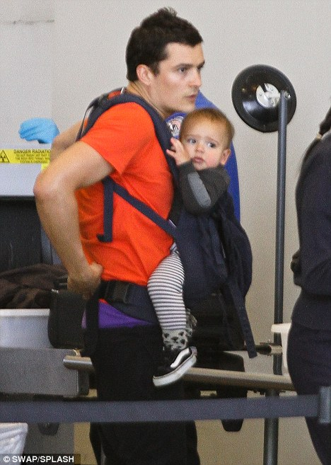 Travelling tot: Orlando headed to the airport on Sunday, just a few days after Flynn flew into Los Angeles from Sydney with his mother Miranda Kerr