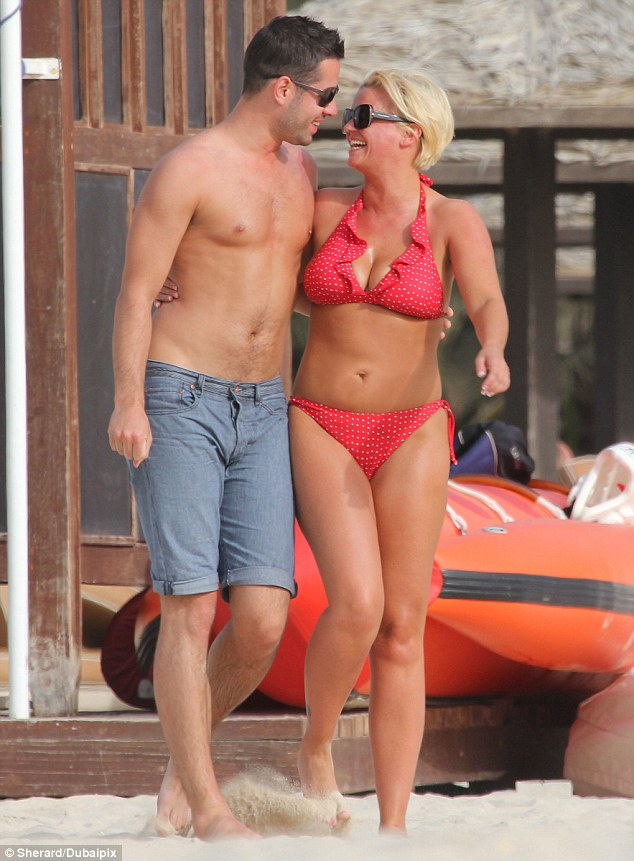 Can't take my eyes off you: Kerry Katona gazes up at her new man Steve Alce as they enjoy a short break to Dubai on their first official holiday together
