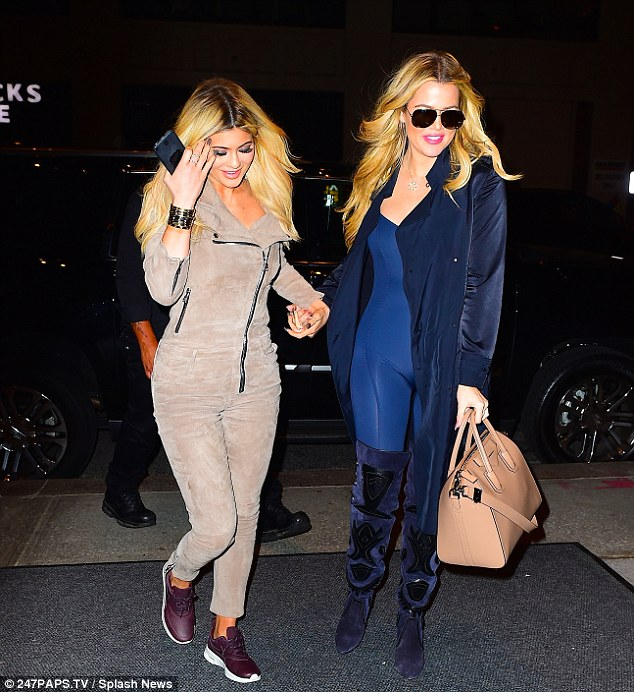 Blondes have more fun! Kylie and Khloe both wore sexy one-pieces for their evening out on the town