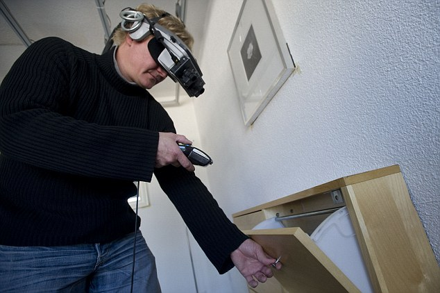 Wild: Mr Torpus tests the immersive augmented reality equipment in his workshop in Basel