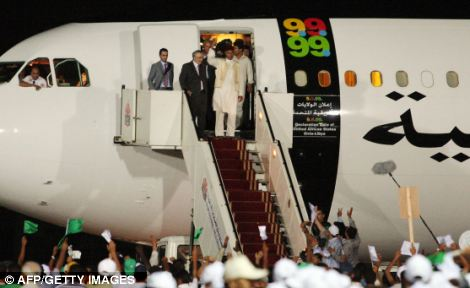 A hero's welcome: Libyan Abdel Baset al-Megrahi, top left, is greeted by cheering crowds upon his arrival at airport in Tripoli, Libya, on August 20, 2009