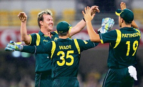 Australia's Matthew Wade (35) and James Pattinson (19) congratulate Brett Lee on taking the wicket of Sri Lanka's Kumar Sangakkara