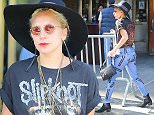 EXCLUSIVE: Lady Gaga shows her metal head side, sporting a Slipknot T shirt, as she steps out wearing a floppy hat and carrying a customized purse with a picture of Lady Gaga and her two dogs in New York City  Pictured: Lady Gaga Ref: SPL1125876  140915   EXCLUSIVE Picture by: Felipe Ramales / Splash News  Splash News and Pictures Los Angeles: 310-821-2666 New York: 212-619-2666 London: 870-934-2666 photodesk@splashnews.com