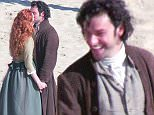 Poldark Filming in Cornwall, UK at Porthcuno beach. (Spoiler Alert) Is Demelza pregnant again?  Pictured: Eleanor Tomlinson and Aidan Turner Ref: SPL1126029  150915   Picture by: MK / Splash News  Splash News and Pictures Los Angeles: 310-821-2666 New York: 212-619-2666 London: 870-934-2666 photodesk@splashnews.com