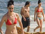 """UK CLIENTS MUST CREDIT: AKM-GSI ONLY EXCLUSIVE: Cancun, Mexico - Actress and former model Krysten Ritter enjoys the warm waters of sunny Cancun as she frolics in a sexy mismatching two-piece bikini, alongside her boyfriend, Adam Granduciel.  The former """"Breaking Bad"""" actress is set to star in the title role of Marvel's """"Jessica Jones"""", which is the second of four Netflix original series set to premiere in November. Kristen appears to be enjoying her mini vacation with her beau, as she looked to be all smiles while showing a bit of PDA with Adam.  Pictured: Krysten Ritter Ref: SPL1125206  130915   EXCLUSIVE Picture by: AKM-GSI / Splash News"""