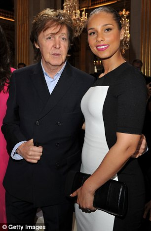 Pride of place: Alicia was sat front row at the Fashion Week show next to Stella's famous father Paul