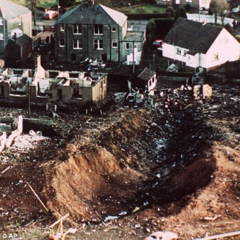Devastation: Prosecutors believe the suitcase in which the bomb was hidden was loaded on to a plane in Malta, and eventually ended up on Pan Am Flight 103 in the sky above southern Scotland, before exploding and causing this gash in the ground