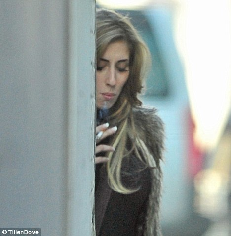 Sneaky puff: Seven months pregnant Stacey Solomon was spotted smoking down an alley way