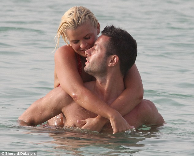 For your eyes only: The new couple seemed oblivious to anyone else as they hugged in the sea