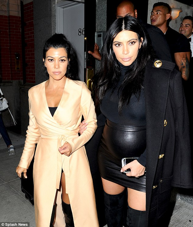 It's a twin thing! With their raven hair and sexy outfits, Kourtney and Kim - the eldest Kardashian sisters - looked remarkably similar
