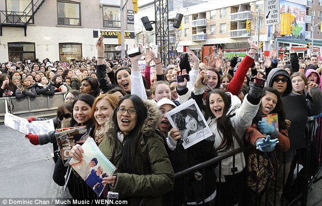 Directioners: Thousands of screaming fans turn out in Toronto, Canada, to catch a glimpse of the boy band