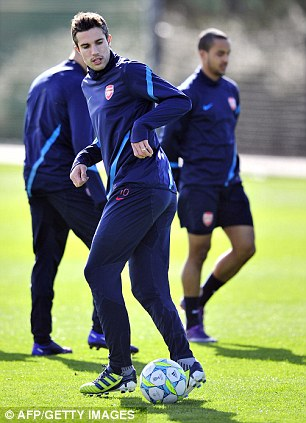 Leader of the pack: In-form Van Persie takes a touch of the ball in training
