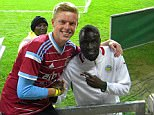 South Africa-based West Ham fan Richard Faasen poses with midfielder Cheikhou Kouyate in Soweto