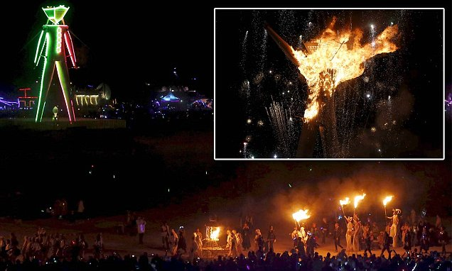 Burning Man attendees watch as festival's 60ft effigy gets torched