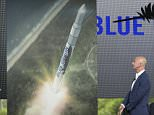 Amazon CEO Jeff Bezos, left, unveils the new Blue Origin rocket, as Florida Gov. Rick Scott watches during a news conference at the Cape Canaveral Air Force Station in Cape Canaveral, Fla., Tuesday, Sept. 15, 2015. Bezos announced a $200 million investment to build the rockets and capsules in the state and launch them using the historic Launch Complex 36. (AP Photo/Phelan M. Ebenhack)
