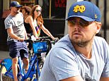 142456, EXCLUSIVE: Leonardo DiCaprio spotted out riding Citi bikes with a mystery girl and other friends in NYC. New York, New York - Tuesday September 15, 2015. Photograph: © RGK, PacificCoastNews. Los Angeles Office: +1 310.822.0419 sales@pacificcoastnews.com FEE MUST BE AGREED PRIOR TO USAGE