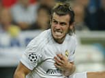 Real Madrid's Gareth Bale grimaces in pain after he injured during a Group A Champions League soccer match between Real Madrid and Shakhtar Donetsk at the Santiago Bernabeu stadium in Madrid, Spain, Tuesday, Sept. 15, 2015. (AP Photo/Paul White)