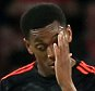 Manchester United players dejected after PSV Eindhoven score