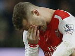 Arsenal's English midfielder Jack Wilshere lies injured during the English Premier League football match between Arsenal and Manchester United at the Emirates Stadium in London on November 22, 2014. AFP PHOTO/ADRIAN DENNIS  RESTRICTED TO EDITORIAL USE. NO USE WITH UNAUTHORIZED AUDIO, VIDEO, DATA, FIXTURE LISTS, CLUB/LEAGUE LOGOS OR LIVE SERVICES. ONLINE IN-MATCH USE LIMITED TO 45 IMAGES, NO VIDEO EMULATION. NO USE IN BETTING, GAMES OR SINGLE CLUB/LEAGUE/PLAYER PUBLICATIONS.        (Photo credit should read ADRIAN DENNIS/AFP/Getty Images)