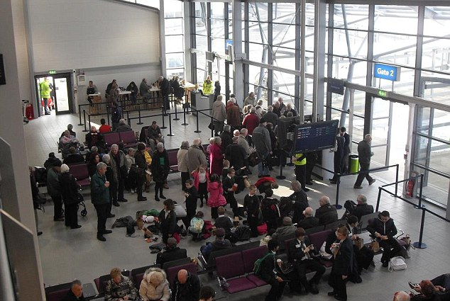 Get away! Passengers wait to board one of the first flights out of London Southend Airport
