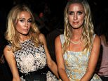 NEW YORK, NY - SEPTEMBER 15: Paris Hilton (L) and Nicky Hilton Rothschild attend Dennis Basso Front Row & Backstage Spring 2016 New York Fashion Week: The Shows at The Arc, Skylight at Moynihan Station on September 15, 2015 in New York City.  (Photo by Desiree Navarro/WireImage)