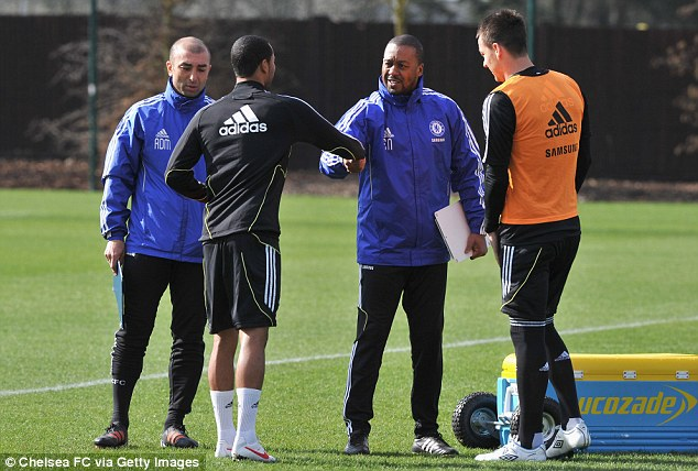 Shake-up: Di Matteo and Newton chat with Ashley Cole and John Terry