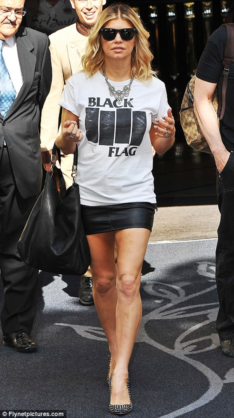 Leggy in leather: Black Eyed Peas singer Fergie shows of her toned and tanned legs in a short leather skirt as she leaves her Paris hotel