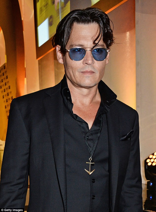 Johnny, pictured attending the GQ Men Of The Year awards at The Royal Opera House in London in September 2014 looks much trimmer and his face appears more chiselled