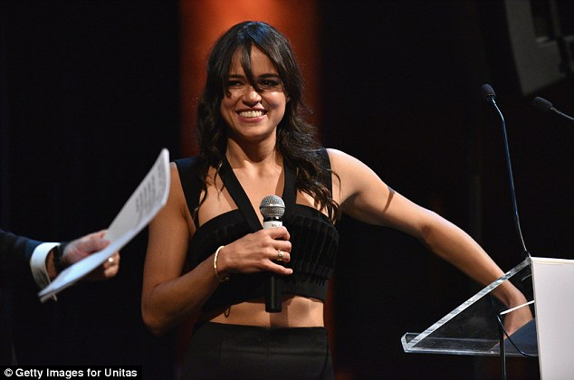 Stage presence: Michelle Rodriguez showed no sign of stage fright while clad in a tiny black midriff-baring top