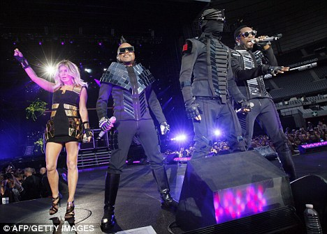 You ready to party, Paris? Fergie joins the rest of the band (L-R apl.de.ap, Taboo and Will.i.am) as they play the Stade Du France