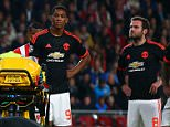 Players look concerned as Luke Shaw of Manchester United is treated for a suspected broken leg during the UEFA Champions League Group B match between PSV Eindhoven and Manchester United played at The Philips Stadion, Eindhoven