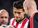 epa04932234 Eindhoven player Hector Moreno looks after Manchester United's Luke Shaw who is stretchered off injured during the UEFA Champions League match between PSV Eindhoven and Manchester United in Eindhoven, the Netherlands, 15 September 2015  EPA/RONALD BONESTROO