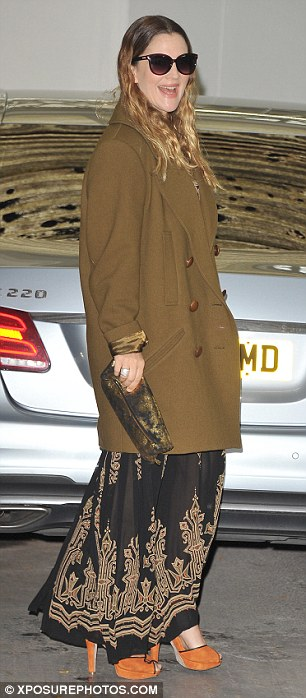 Ready to wow: Barrymore added a splash of colour with a pair of orange heeled sandals