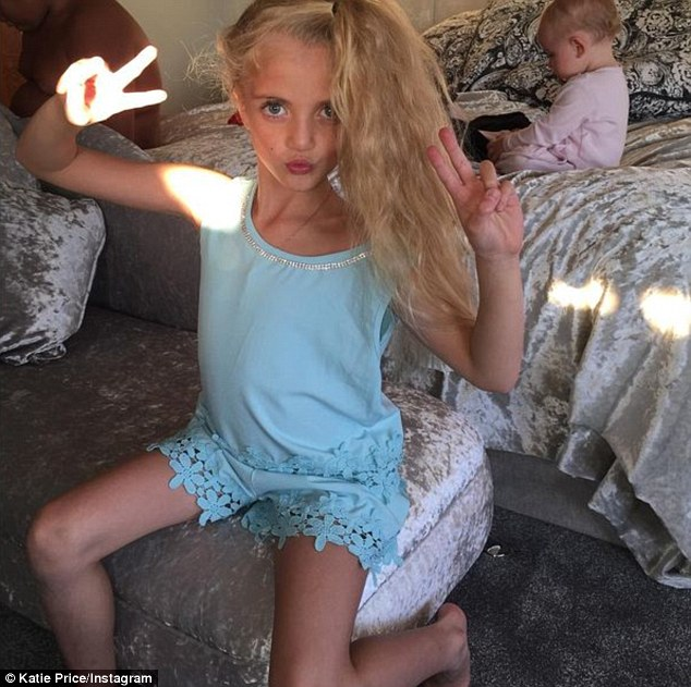 'My mini me': The mother-of-five also posted a picture of her lookalike seven-year-old daughter Princess