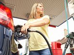 Female Motorist Filling Car With Diesel At Petrol Station