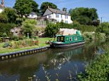 BN098X Green canal barge moored on Grand Western Union Canal near Taunton Somerset UK