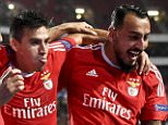 Benfica's Argentinian midfielder Nico Gaitan (C) celebrates a goal with teammate Brazilian forward Jonas Oliveira (L) and Greek forward Konstantinos Mitroglou (R) during the UEFA Champions League football match SL Benfica vs FC Astana at the Luz stadium in Lisbon on September 15, 2015. AFP PHOTO / FRANCISCO LEONGFRANCISCO LEONG/AFP/Getty Images