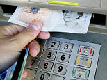 File photo dated 04/04/06 of a person withdrawing money from a cashpoint as Most people want the Government to scrap controversial plans for regional pay, believing the move would be unfair on public sector workers, according to new research. PRESS ASSOCIATION Photo. Picture date: Tuesday September 25, 2012. A survey of over 1,000 adults for the TUC found that only one in four supported the idea of different wage rates for nurses, teachers and other workers, in different parts of the country. Around two thirds said the plans should be dropped and a similar number described regional pay as unfair. See PA story INDUSTRY Pay. Photo credit should read: Gareth Fuller/PA Wire