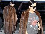 Kim Kardashian rocking a long fur coat and short leather skirt in NYC. The reality queen is also sporting shades and a Pink Floyd shirt. September 15, 2015 X17online.com