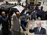 "Mourners carry the coffin of Egyptian actor Omar Sharif for a funeral procession at the Hussein Tantawi Mosque in Cairo, Egypt, Sunday, July 12, 2015. Sharif, the Egyptian-born actor with the dark, soulful eyes who soared to international stardom in movie epics, ""Lawrence of Arabia"" and ""Doctor Zhivago,"" died in a Cairo hospital of a heart attack, on Friday, July 10. He was 83. (AP Photo/Hassan Ammar)"
